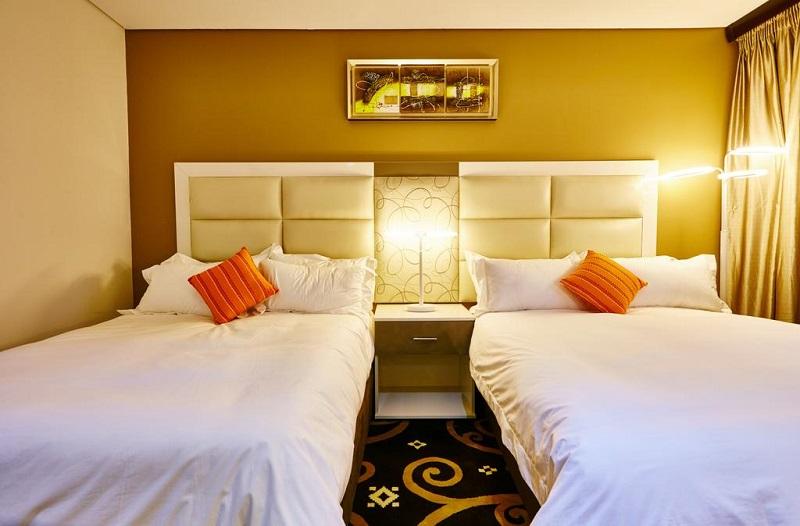 Quarto do Palm Continental Hotel em Joanesburgo